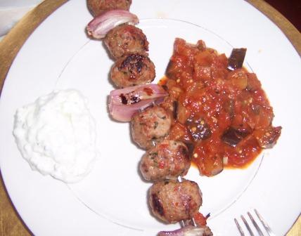 Shish kebab with eggplant hash and Tzaziki sauce