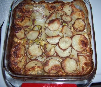 Pork cutlets baked in creamy potatoes