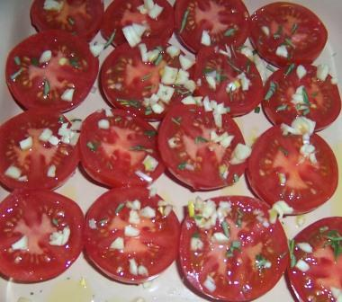 Tomatoes prepped for oven roasting